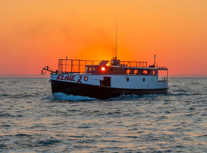 Photo of Elsie J at sunset on Lake Michigan - What to do in South Haven