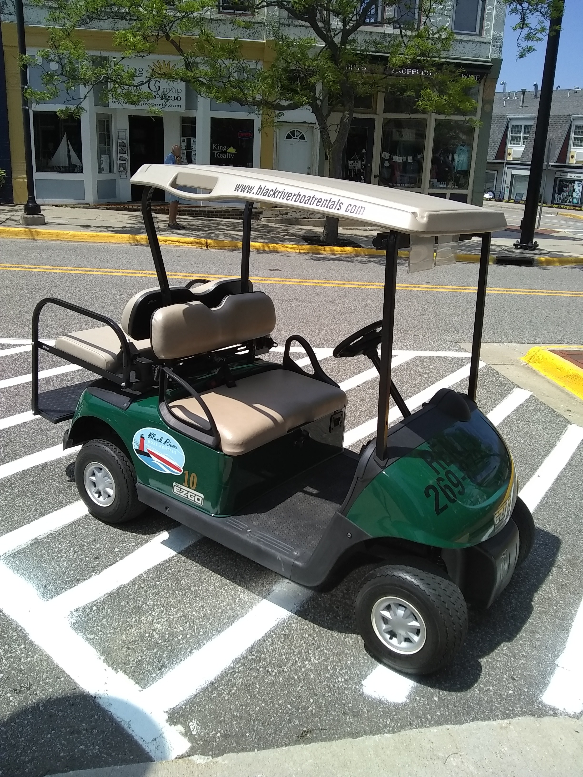 Picture of Black River Boat Rentals golf cart on the street - What to do in South Haven