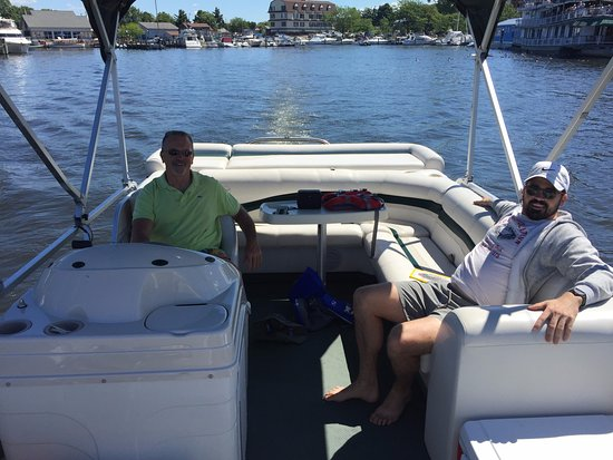 Two gentlemen riding on a pontoon boat down the Black River - What to do in South Haven