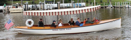 Picture of the Lindy Lou vessel loaded with patrons motoring down the Black River - What to do in South Haven